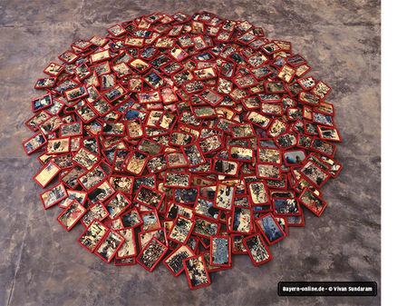 Vivan Sundaram: Great Indian Bazaar, 1997. 1400 postcard-sized photographs in metal frames in a circular floor installation. Collection the Artist